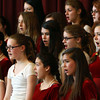 The Miles River Middle School 7th and 8th grade chorus sings a song during the Middle Schol Arts Night on Wednesday. David Le/Staff Photo