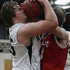 Hamilton-Wenham's Shane Jenkins (35) left, finds himself with his eye on the ball as he battles for a rebound with Masco's Sean Antonuccio (33) right. David Le/Salem News