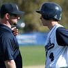 New Hamilton-Wenham baseball head coach Reggie Maidment talks with junior Nick Tufts. David Le/Staff Photo