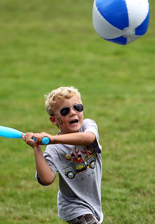 Max Pavlik, 4, of Beverly, keeps his eyes on a beach ball while playing with his grandparents at the Beverly Homecoming Lobster Festival on Wednesday afternoon. David Le/Staff Photo