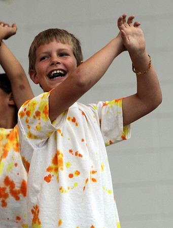 "Bryce Caron, 10, lip synchs to ""Here Comes the Sun"" by the Beatles on Tuesday evening. David Le/Staff Photo"