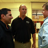 Newly elected Ipswich Selectman Nishan Mootafian, left, talks with Hugh O'Flynn,  who was re-elected to the Ipswich School Committee, and Rich Kallman, of Ipswich on Tuesday evening. David Le/Staff Photo