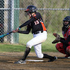 Beverly first baseman Kate Silvestri lines a base hit against Salem on Tuesday afternoon. David Le/Staff Photo