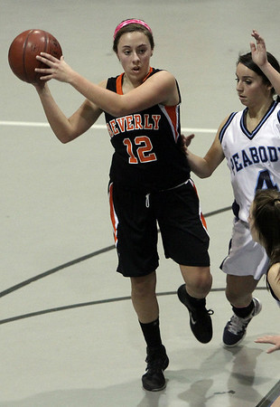 Beverly's Erin Silvestri (12) left, looks to pass while being defended by Peabody's Victoria Digiacomo (4) right, on Tuesday night. David Le/Salem News