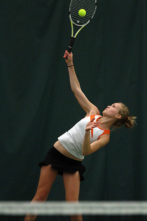 Ipswich High School first singles player Alex Sulkin smashes a serve at her Bedford opponent on Friday afternoon during the D3 North Final match at the Bass River Tennis Club. David Le/Staff Photo