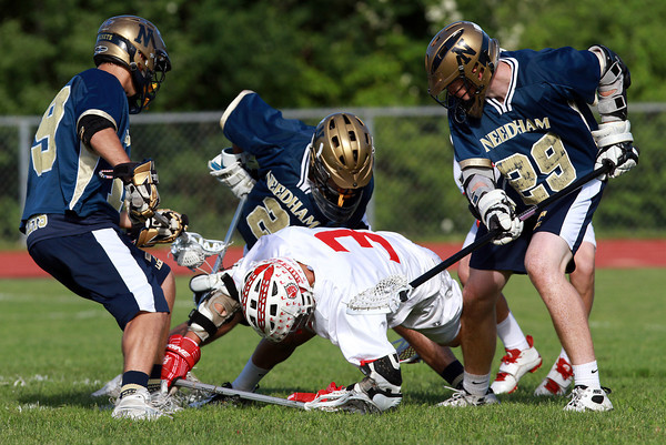 Masco's Wes Shrewsbury, center, battles for control of the ball in between three Needham defenders. David Le/Staff Photo
