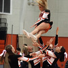 Beverly: Beverly High School senior Melanie Cram gets caught by her teammates after a twirling jump during the halftime show of the Beverly-Lynn Classical game on Tuesday evening. David Le/Salem News