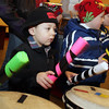 Beverly: Jayce Frontiero, 4, of Gloucester, plays the african drums during a drumming circle on Saturday night. David Le/Salem News