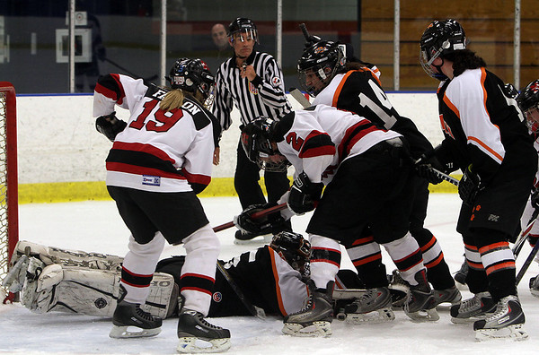 Beverly goalie Jenna LoVasco (center) dives foward to cover up a puck against Marblehead on Saturday. David Le/Salem News