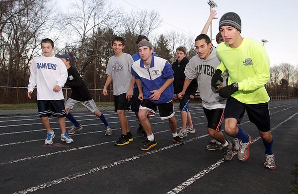 The Danvers High School boys distance runners begin a workout on Thursday afternoon. David Le/Salem News