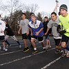 The Danvers High School boys distance runners begin a workout on Thursday afternoon. David Le/Salem News