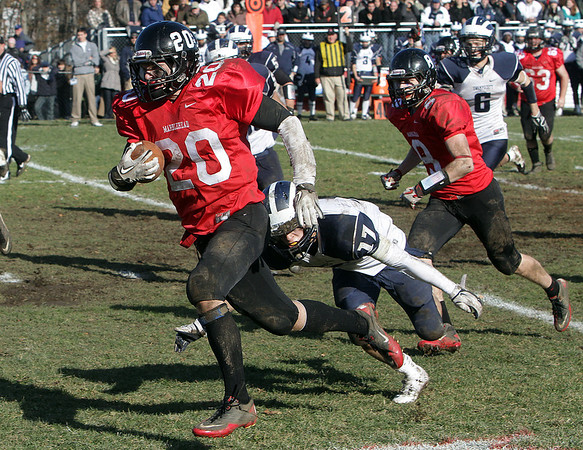 Marblehead running back Will Quigley (20) rushes for his second long touchdown of the morning, beating Swampscott defender Richard Sullivan (17). David Le/Salem News
