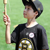 Jake Vella, 10, from Brampton, ON, focuses while trying to catch the ball in the cup at the House of 7 Gables on Thursday afternoon. David Le/Staff Photo