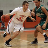 Beverly: Beverly's Chris Keaton (33) drives past a Lynn Classical defender on Tuesday night. David Le/Salem News