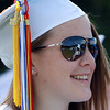 Danvers High School senior Hayley Dyer smiles as she listens to her Class Officers speak during Graduation Saturday morning. David Le/Staff Photo