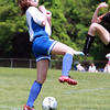 Danvers Girls U-14 Tornados player Devon Walsh, left, battles for a 50/50 ball with a Woburn player during the Danvers Invitational Tournament on Monday morning. David Le/Staff Photo