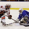 Salem: Beverly's Connor Irving dekes Danvers goalie Seth Kamens and scores on Friday night. David Le/Salem News