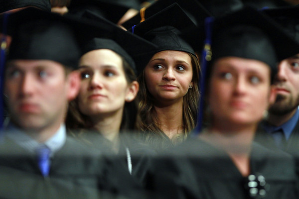 Salem State senior Hollie Salvo, of Danvers, glances up at the big screen during Commencement on Saturday afternoon. David Le/Staff Photo