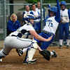 Peabody catcher Olivia Brothers, left, waits for the ball to arrive as Danvers's Julia Saggese, right, slides into home plate on a close play on Wednesday afternoon. David Le/Staff Photo