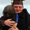 Bishop Fenwick graduate Will Clancy hugs Sister Catherine Fleming after receiving his diploma on Friday evening. David Le/Staff Photo