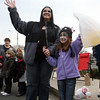 Ana Ortiz, left, and Madison Stocker, 7, of Beverly, wave as the Annual Beverly Holiday Parade passes by on Sunday afternoon.David Le/Salem News