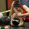 Masco's Richard Santasvesso, right, comes extremely close to pinning his opponent on Saturday afternoon during the state semifinal wrestling meet at Beverly High School. David Le/Salem News