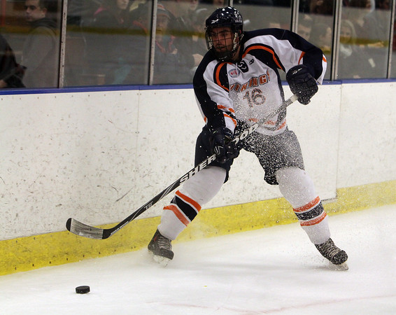 Salem State's Tom Mahoney passes the puck down the boards to a teammate on Thursday night. David Le/Salem News