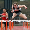 Beverly freshman Kendel Davy, right, leaps high over a hurdle during the 100 meter high hurdles while competing against Salem senior Dasha Corpuz, left, on Tuesday afternoon. David Le/Staff Photo
