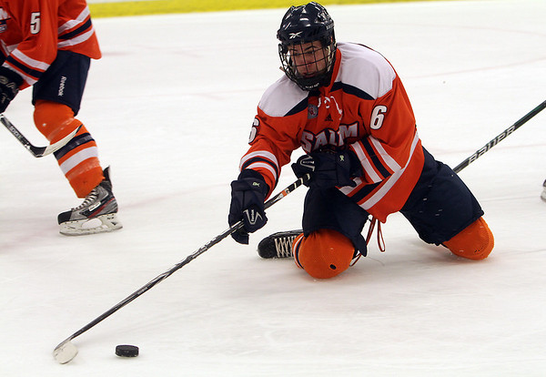 Salem State's Mark MacDonald passes the puck to a teammate from his knees against Plymouth State. David Le/Salem News