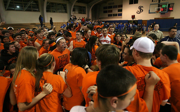 Ipswich High School fans storm the court following a 46-38 victory over Bedford High School on Wednesday night at St. John's Prep. David Le/Staff Photo