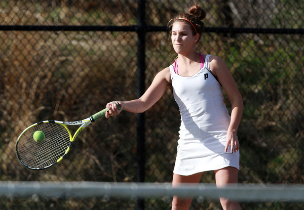 Marblehead 1st Doubles player Meghan Stanojev keeps her eye on the ball as she returns a serve against Masconomet on Wednesday afternoon. David Le/Staff Photo