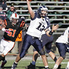 Swampscott quarterback Mike Walsh drops back and completes a pass to a teammate during the Big Blue victory over Beverly on Saturday afternoon. David Le/Salem News