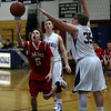 Masco's Alex Brown scoops in a layup around Hamilton-Wenham's Shane Jenkins (35) on Tuesday night. David Le/Salem News