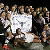 The Peabody High School girls soccer team poses with the championship trophy and banner. David Le/Salem News
