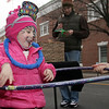 Beverly: Rylee McLaughlin, 3, of Beverly, dances around in a hula-hoop on Cabot St. on New Year's Eve. David Le/Salem News