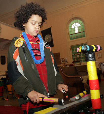 Beverly: Ali Khamis, 8, of Lynn, plays musical blocks on New Year's Eve. David Le/Salem News