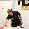 Peabody: Boston Bruins forward prospect Nick Tremblay plays air hockey against an elderly patient at the Pilgrim Rehab Center in Peabody on Friday afternoon. Photo by David Le/Salem News