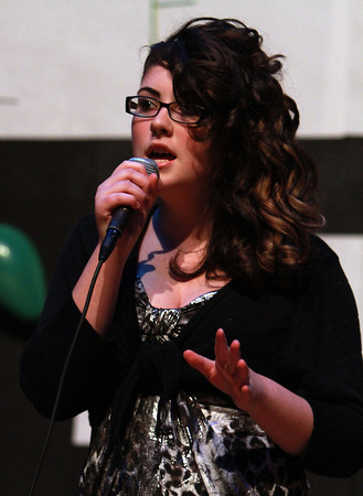 "Collins Middle School singer Veronica Cook sings ""Pricetag"" by Jessie J at the Middle School Talent Show on Thursday evening. David Le/Staff Photo"