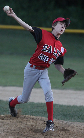 Gloucester: Salem American's relief pitcher Aaron Smart, delivers a pitch during Salem's opening round game against Beverly East held in Gloucester on Friday evening. Photo by David Le/Salem News
