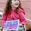Aymee Michel, 6, of Hamilton, does some arts and crafts projects while watching the Beverly-Salem lacrosse game with her babysitter Adrienne Baker, of Beverly, on Thursday afternoon. David Le/Staff Photo