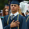 Peabody graduate Steve Girolamo places his hand over his heart during the singing of the National Anthem at the start of the Peabody High School Graduation on Friday evening. David Le/Staff Photo