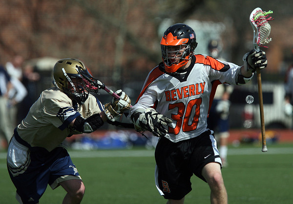 Beverly's Brendan Flaherty (30) right, fends off a Malden Catholic defender on Saturday afternoon. David Le/Staff Photo