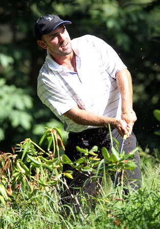 Matt Michel, of Danvers, chips the ball out of some tall grass near the 17th green during the North Shore Amateur Championship on Wednesday afternoon. David Le/Staff Photo