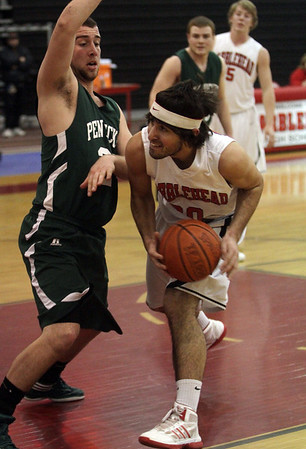 Marblehead's Brian Gellert (20) right, looks for a shot while being defended. David Le/Staff Photo