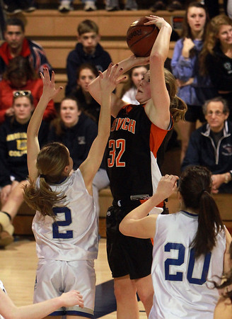 Ipswich junior Julia Davis (32) rises up over Bedford's Kristen Baratta (2) and hits a jump shot. David Le/Staff Photo