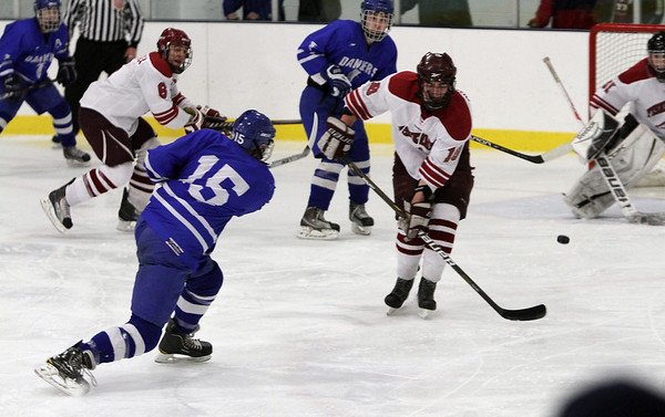 Danvers defenseman Nick Strangie (15) rifles a shot on net against Gloucester. David Le/Staff Photo