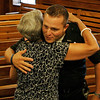 Beverly: Beverly Police Officer William Barror gets a hug and kiss from his aunt, Emily Morency, of Beverly, after Barror was honored in a special ceremony held at Beverly City Hall on Tuesday evening for his brave actions during an apartment fire on Mill Street on the 4th of July. Photo by David Le/Salem News