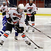 Salem: Beverly captain controls the puck while being hassled by a Danvers defender. David Le/Salem News
