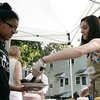 Natasha Osborne, of Danvers, serves BBQ ribs to Fradelin Pimentel, of Beverly, at the Beverly Bootstraps Mobile Market on Tuesday afternoon. David Le/Staff Photo
