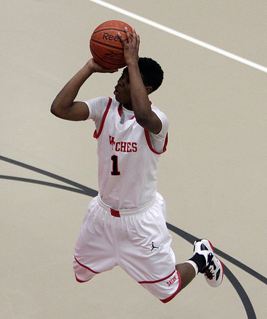 Salem guard Christian Dunston rises up for a jump shot against Danvers. David Le/Salem News